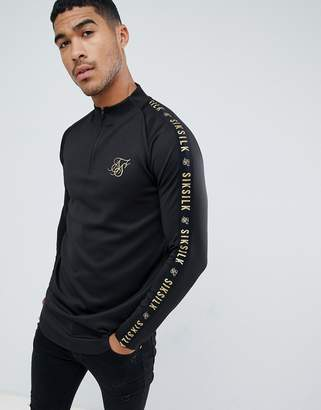 SikSilk long sleeve top in black with gold logo and sleeve detail