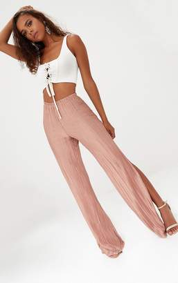 PrettyLittleThing Petite Pink Pleated Split Wide Leg Trousers
