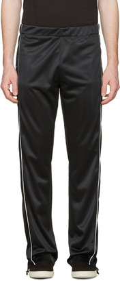 Maison Margiela Black Snap Track Pants $975 thestylecure.com