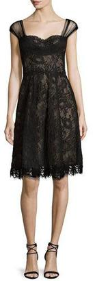 Monique Lhuillier Lace Cross-Back Cocktail Dress, Noir $2,995 thestylecure.com