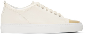 Lanvin Ivory & Gold Leather Sneakers $650 thestylecure.com
