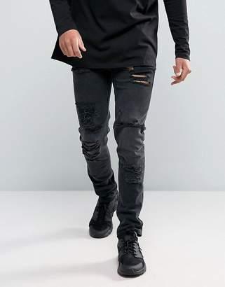 Asos Design DESIGN skinny jeans in 12.5oz with mega rips in washed black