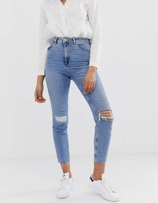 Asos Design DESIGN Farleigh high waisted slim mom jeans in light vintage wash with busted knee and rip & repair detail