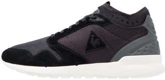 OMICRON Trainers black