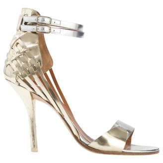 Givenchy Gold Leather Sandals