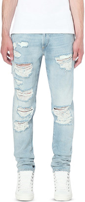 OFF-WHITE C/O VIRGIL ABLOH Distressed slim-fit tapered jeans $375 thestylecure.com
