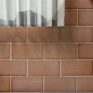 EliteTile Vulcan 3 x 6 Stainless Steel and Porcelain Subway Tile in Copper