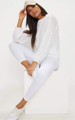 PrettyLittleThing Cream High Neck Rib Long Sleeve Top