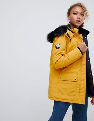 New Look parka coat in mustard with faux fur hood