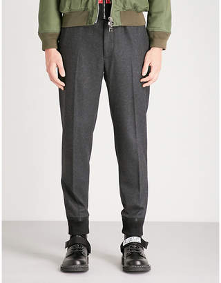 Alexander McQueen Cuffed relaxed-fit skinny wool trousers