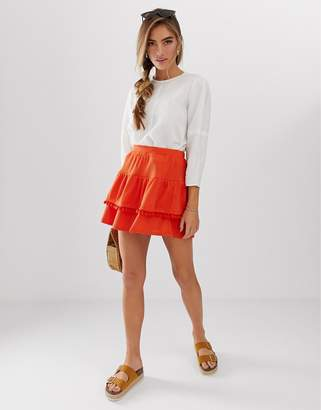 Asos DESIGN lace insert and pom pom mix mini skirt