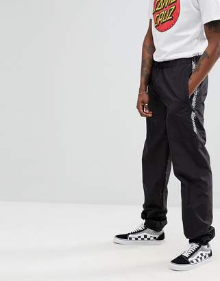Santa Cruz Gamma track joggers with taping in black