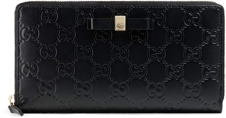 Gucci Bow Gucci Signature zip around wallet