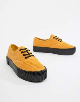 Monki courdroy flatform plimsols in Mustard/black sole