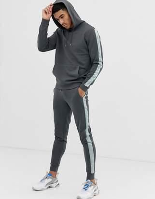 Asos Design DESIGN tracksuit hoodie/skinny sweatpants with satin side stripe in washed black