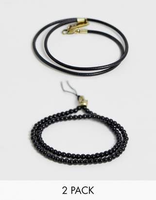 ICON BRAND bracelet with gold skull charm in black