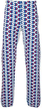 Champion all-over logo print track pants