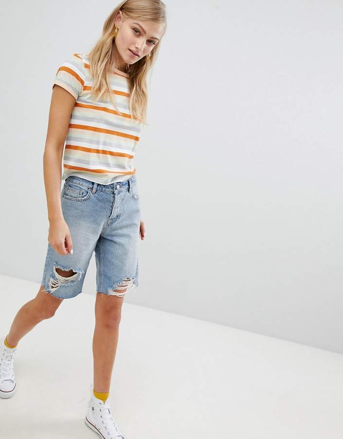ASOS DESIGN denim longline shorts with rips in midwash blue