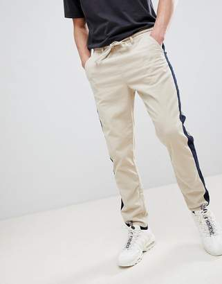 Asos Design DESIGN Tapered Pants In Putty Cord With Navy Side Stripe