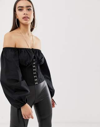 fb0c626ebaa7d Asos Design DESIGN long sleeve off shoulder top with bell sleeves and hook  and eye detail