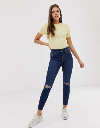 New Look knee rip lift and shape skinny jean in mid blue