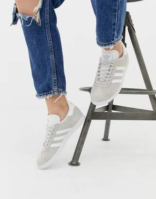 0b3d46a2165d adidas gray and white Gazelle sneakers