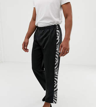 Reclaimed Vintage inspired straight leg pants with zebra side stripe