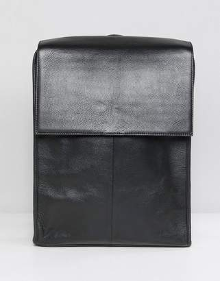 Asos DESIGN leather backpack in black with fold over top
