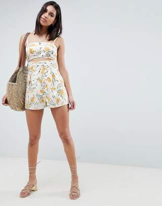 142b6b49030 Asos Design DESIGN cami romper with cut out detail in linen in floral print