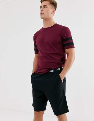 Asos Design DESIGN lounge pyjama short and tshirt set with stripe and branded waistband in burgundy