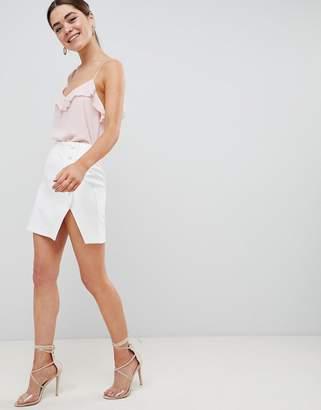 Asos DESIGN side button mini skirt with split front