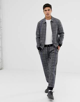 Asos DESIGN tracksuit harrington jacket / tapered joggers in check with piping