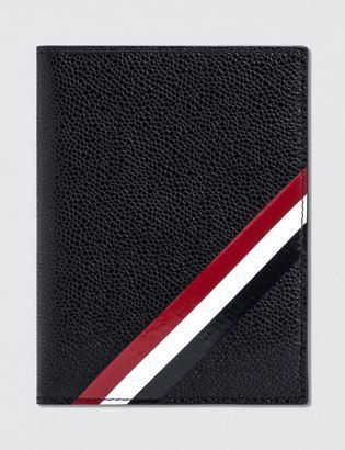 Thom Browne Pebble Grain and Calf Leather Passport Holder with RWB Diagonal Stripe $590 thestylecure.com