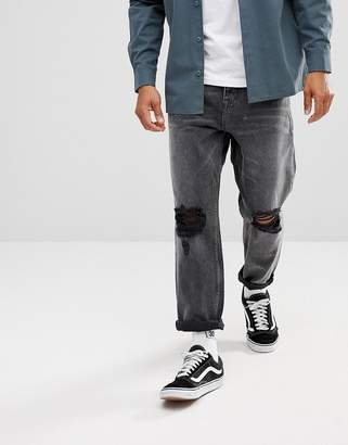 Asos DESIGN Skater Fit Jeans In Washed Black With Rips