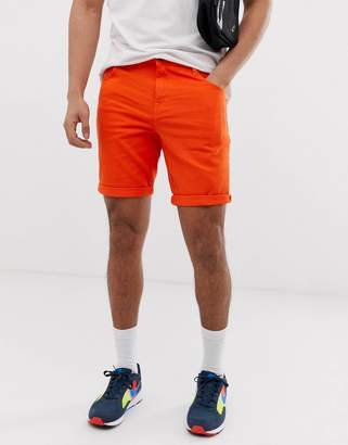 Asos Design DESIGN slim denim shorts in orange
