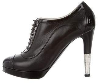 Chanel CC Cap-Toe Lace-Up Booties
