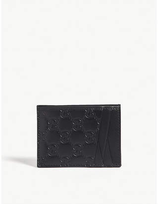 17319ea7ae5e8b Gucci Embossed GG leather card holder