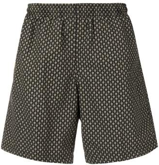 Alexander McQueen skull swim trunks