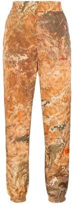 Heron Preston high-waisted camo print track pants