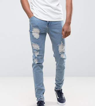 Asos DESIGN TALL Tapered Jeans In Vintage Light Wash Blue With Heavy Rips