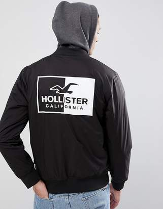 Hollister Back Logo Stretch Bomber Jacket With Sweat Hood in Black