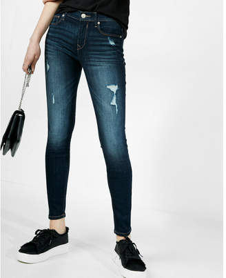 Express dark distressed mid rise jean legging $79.90 thestylecure.com