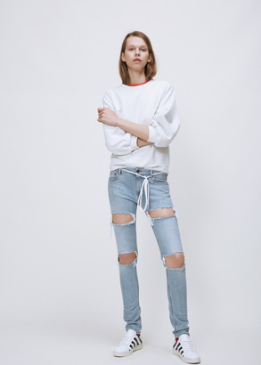 Off-White bleached white ripped skinny 5-pocket $591 thestylecure.com