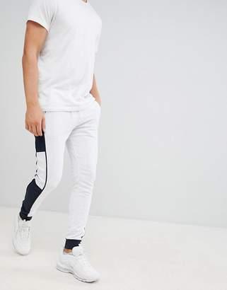 Asos DESIGN super skinny joggers with side stripe
