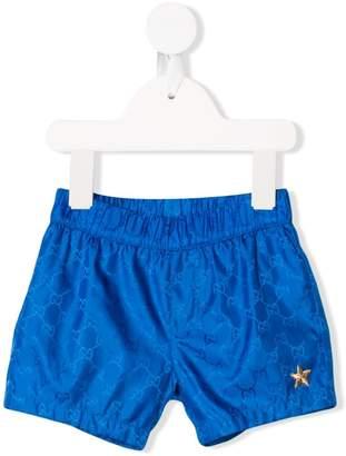0312476b649a9 Trunks Gucci Kids logo embroidered swim shorts