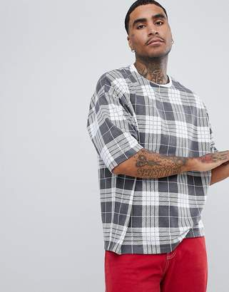 Asos DESIGN oversized t-shirt with all over check print with half sleeve