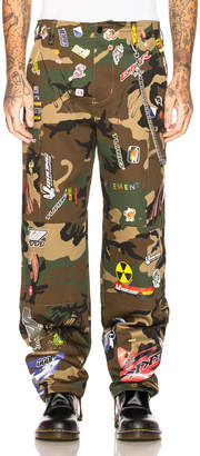 Vetements Sticker Cargo Pants in Dark Green Camo | FWRD