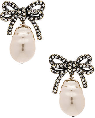 At Revolve Marc Jacobs Large Bow Pearl Earrings