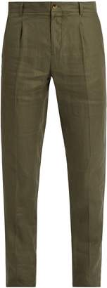 DE BONNE FACTURE Pleated-front tapered-leg linen trousers