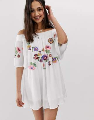 En Creme bardot mini dress with floral embroidery